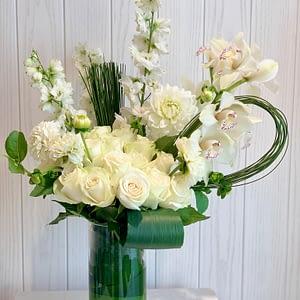 All white in glass vase